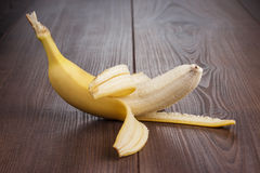 Fresh peeled banana on the brown background Stock Photography
