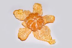 Peeled mandarin on white background royalty free stock photography