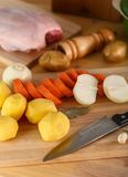 Fresh peeled vegetables, potatoes, carrots and onions on the cutting Board. Fresh peeled vegetables, potatoes, carrots, onions and chicken on the cutting Board Royalty Free Stock Photography