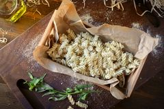 fresh raw pasta in basket stock images