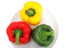 Fresh pepper. Closeup image of fresh pepper green red and yellow on plate and white background Royalty Free Stock Photos