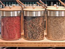 Colorful fresh peppercorns, various spices and colours, close up, jars, stockpot, ingredients royalty free stock photo