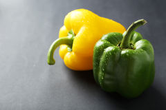 Fresh pepper with water drops on a grey background Stock Photo