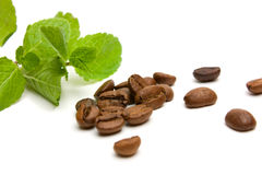 Fresh peppermint and coffee beans on white Royalty Free Stock Images