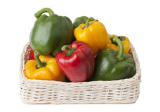 Fresh peppers in basket on white background Royalty Free Stock Photos