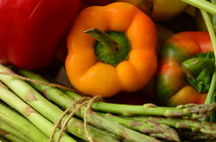 Fresh peppers and bunch of asparagus Stock Photography
