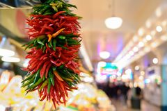 Fresh peppers hanging at market stock photo