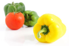 Fresh peppers and tomatoe Royalty Free Stock Photos