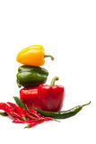 Fresh peppers on white backround. Fresh yellow, red and green pepper isolated on a white background Stock Image