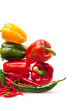 Fresh peppers on white backround. Fresh yellow, red and green pepper isolated on a white background Stock Images