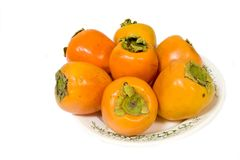 Fresh persimmon. On isolated background Royalty Free Stock Images