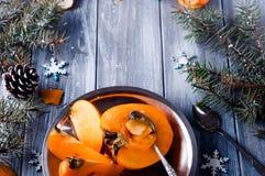 Fresh persimmon fruit and mandarin Royalty Free Stock Photo