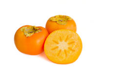Fresh persimmon fruit sliced and whole Stock Photo
