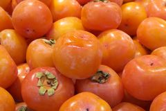 Fresh persimmon in market Stock Images