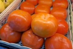 Fresh persimmon Stock Photos