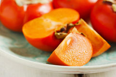 Fresh persimmons Royalty Free Stock Photo