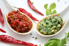Fresh pesto. A fresh italian pesto of basil and chili on a spoon Royalty Free Stock Photos
