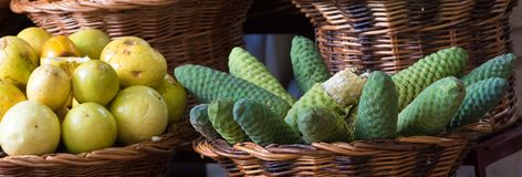 Fresh Philodendron fruit and maracuja in basket. On Madeira market stock photos