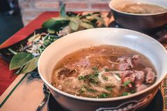 Fresh Pho Bo beef soup in a bowl in Saigon Vietnam stock photography