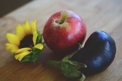 Fresh picked Apples, Eggplant, and Sunflower shot in Puerto Rico. Organic farming, fresh farmers market fall harvest. Delicious or stock images