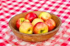 Fresh Picked Apples. In a Wooden Bowl on Red Gingham Table Cloth Royalty Free Stock Image