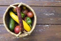 Fresh picked garden vegetables. Home gardener basket full of fresh picked home grown vegetables Stock Image