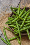 Fresh picked green beans on a wooden table Royalty Free Stock Photo