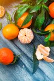 Fresh picked Mandarin on the grey wooden background stock images