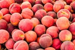 Fresh picked peaches on display Royalty Free Stock Photos