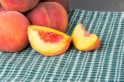 Fresh picked peaches sliced and whole Royalty Free Stock Images