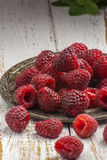 Fresh picked raspberries on a wooden table Royalty Free Stock Photography