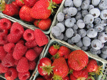 Fresh picked strawberries, raspberries and Blueberries. From home garden. Fruit in paper containers, angle format Stock Photos