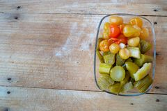 Pickled cucumbers and peppers stock photos