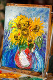 Fresh picture, oil painting on canvas in studio. Sunflowers. Fresh picture oil painting on canvas in studio. Vertical. Sunflowers royalty free stock image
