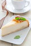 Fresh piece of cheesecake. Cheesecake with mint on plate Stock Image