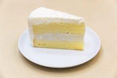 Fresh piece of coconut cream cake Stock Images
