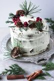 Piece of homemade cake with persimmon decorated with frosting cream cheese and sprinkled with chocolate in the New Year decoratio Stock Photo