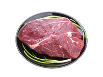 Fresh piece of raw beef isolated on white background. Fresh piece of raw beef on plate isolated on white background Stock Photo