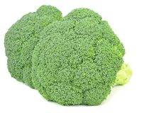 Fresh Pieces of Broccoli. Two pieces of fresh broccoli on a white background Royalty Free Stock Images