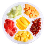 Fresh pieces of fruits in plastic container isolated on white. Background. Healthy life. Different kinds of sliced fruits: mango, watermelon, melon, grapes stock images