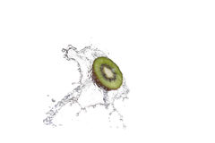 Fresh pieces of kiwi in water splash, isolated on white background Stock Photo