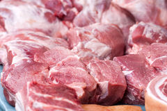 Fresh pieces of pork on the market counter. Selective focus.  Stock Photography