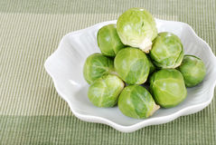 Fresh pile of brussel sprouts. Top view of Fresh pile of brussel sprouts on green tablecloth Royalty Free Stock Photography