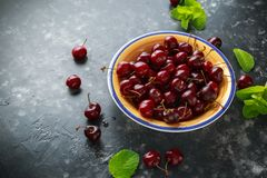 Fresh pile of ripe cherries in bowl. healthy summer fruit food stock photos