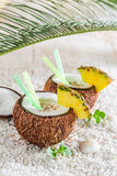 Fresh pinacolada in coconut with pineapple and mint leaves Stock Photography