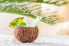 Fresh pinacolada in coconut on sandy beach Stock Photos
