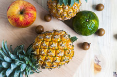 Fresh pineapple on the background. Pineapple on the background table Stock Photos