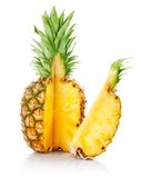 Fresh pineapple with cut and green leaves Royalty Free Stock Photos