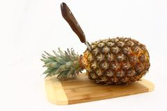 Fresh Pineapple On Cutting Board With Knife Stock Image
