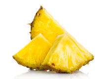 Fresh pineapple fruit slices isolated on white Royalty Free Stock Image